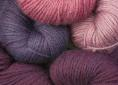 BFL superwash wool dyed with cochineal extract and overdyed with indigo